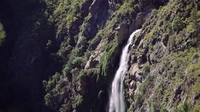Waterfall in the forest, Chile. Tilt Up. `Salto del Agua` waterfall in the forest near of Valparaiso, Chile stock footage