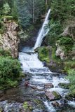 Waterfall in the forest, Dolomites Stock Image