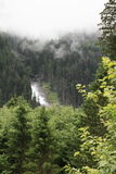 Waterfall in forest. Foggy waterfall in forest mountains by Mittersill (Alps, Austria) at summer time Royalty Free Stock Photography