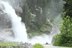 Waterfall in forest. Foggy waterfall in forest mountains by Mittersill (Alps, Austria) at summer time Royalty Free Stock Photo