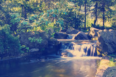 Waterfall in forest. Instagram nashville Tone Waterfall landscape In the deep forest on mountain Royalty Free Stock Photo