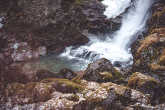 Waterfall in the forest. With moss stones Stock Images