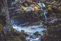 Waterfall in the forest. With moss stones Stock Photography