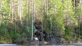 Waterfall in the forest near Lake. Video stock video footage