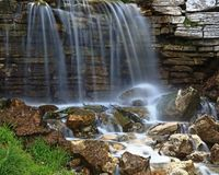 Waterfall in Forest Park. Stream running through Forest Park in St. LOUIS, Missouri and falling over rocky outcrop Stock Photos