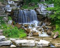 Waterfall in Forest Park. Stream running through Forest Park in St. LOUIS, Missouri and falling over rocky outcrop Stock Images