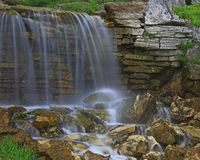Waterfall in Forest Park. Stream running through Forest Park in St. LOUIS, Missouri and falling over rocky outcrop Stock Photo
