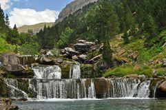 Waterfall in the forest, Pyrenees Spain stock photo