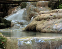 Waterfall in forest river Stock Photos