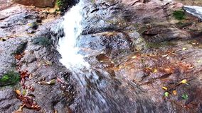 Waterfall in the forest and the rocks covered with moss. Huai Yang waterfall in Nam Tok Huai Yang National Park, Thailand n stock video footage