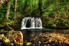 Waterfall. In the forest, Romania Stock Photos