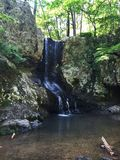 Waterfall in the forest. A small waterfall in the forest Stock Images