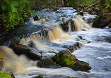 Waterfall on forest stream long exposure Stock Photo