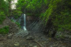 Waterfall in the forest. A summer evening a waterfall in the forest Stock Photos
