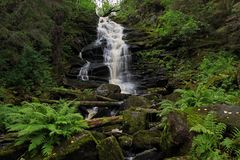 Waterfall white bridges. Waterfall in the forest Stock Photos