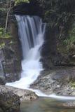 Waterfall formed bend flow. As smooth as silk waterfall, bending the flow of water Stock Image