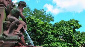 Waterfall Fountain and Angel Statue in Frankfurt. Germany stock video footage