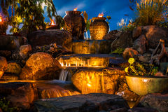 Waterfall fountain landscape at night. Creates a beautiful soothing ambiance Stock Images