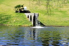 Waterfall From Man Made Bridge Into Lake Stock Images