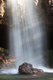 After the waterfall from the front of the cave. Sunlight slanted on the waterfall, waterfall here is a big rock Royalty Free Stock Photo