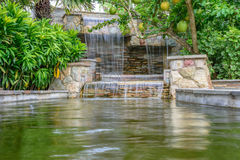 The waterfall in garden. The landscape of beautiful waterfall in garden royalty free stock photo