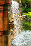 Waterfall in the garden - a lion's head statue. Royalty Free Stock Photography