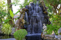 Waterfall in garden Royalty Free Stock Image