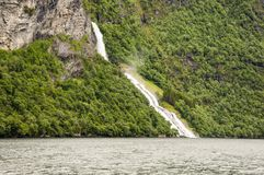 Waterfall in the Geiranger fjord Royalty Free Stock Image