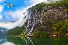 Waterfall in Geiranger fjord Norway stock images