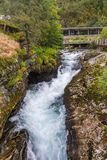 Waterfall in Geiranger with Norwegian Fjord Centre in Norway Royalty Free Stock Photos