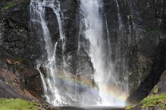 Waterfall. Gigantic waterfall scene with a lovely rainbow at its bottom