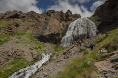 The Waterfall of the Girl Scythe on the mountains of the Elbrus region. Slope of the mountains of the Elbrus region at summer stock photos