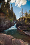 Waterfall at Glacier National Park, Montana Stock Images