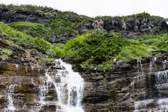 Waterfall in Glacier National Park, USA Stock Photos