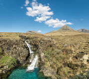 Waterfall in Glen Brittle valley. Cuillin Hills. Isle of Skye. Beauty waterfall with amazing cyan colored water pool in springtime. Clear and sunny day in Glen Stock Image