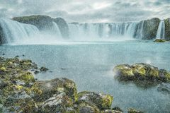Waterfall Godafoss. A beautiful waterfall Winter view, frozen motion of water streams on a long exposure. The most visited waterfall in Iceland. Waterfall Stock Photo