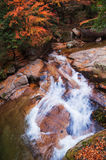 Waterfall in golden fall forest Stock Photo