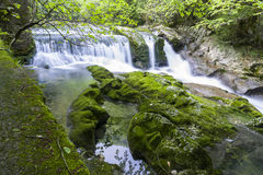 Waterfall in the gorge Chernigovka Stock Photo