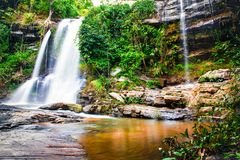 Waterfall in green forest in jungle,Maesapok village nature back. Beautiful waterfall in green forest,Maesapok village Chiang mai Thailand Stock Photo