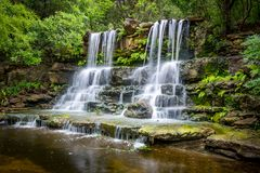 Waterfall in green forest Royalty Free Stock Photos