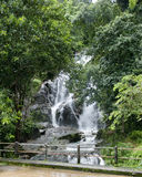 Waterfall  and Green Forest in Rainy Season Royalty Free Stock Image