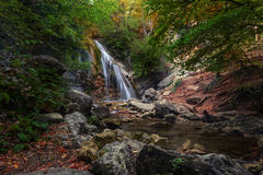 Waterfall in the green forest. Small mountain waterfall in the green forest Stock Image