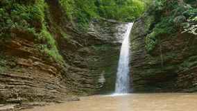 Waterfall in green forest stock video footage