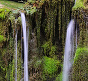Waterfall and green moss. Waterfall over green moss covered rocks Royalty Free Stock Photo