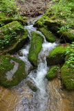 Waterfall. Green mountains with a field Stock Photography