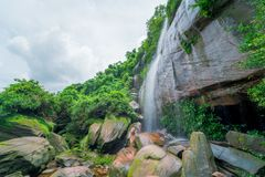 Waterfall in green rainforest. In Thailand Stock Photos