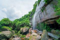 Waterfall in green rainforest Stock Photos