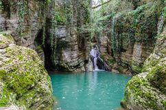 Waterfall in the green ravine royalty free stock image
