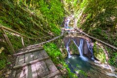 33 Waterfalls, Sochi, Russia. Waterfall in a green spring forest surrounded by a ladder railing and railing, summer natural landscape royalty free stock photos