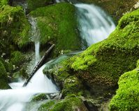 Waterfall in green stone Stock Photography